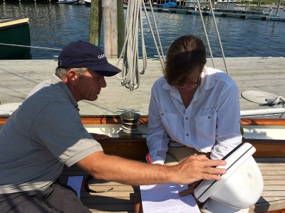Kevin Boughton of Midcoast Marine Electronics helps skipper Carol Vernon sort out an electronics miscommunication issue
